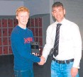 ??  ?? Ross Milne was presented with a sgian dubh set to mark his selection for the Scotland under-16s squad.