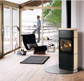 ??  ?? Above: The HWAM 4660 (www.hwam. com) is a wood burning stove with a nominal heat output of 7kw (with a range of 3kw-9kw). Left: The ivory enamelled Manchester wood burner is available from Eurostove (www. eurostove.co.uk) and has a nominal output of 12.6kw