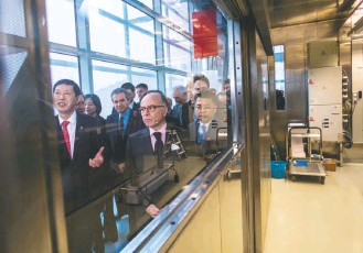 ?? JOHANNES EISELE/AGENCE FRANCE-PRESSE/GETTY IMAGES ?? In 2017, French Prime Minister Bernard Cazeneuve, center, visits the P4 lab in Wuhan. Based on the French P4 lab in Lyon, it is state-of-the-art, unlike other, aging Wuhan Institute of Virology buildings.