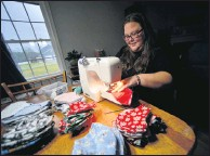 ?? THE ASSOCIATED PRESS ?? Bethany Ranquist of Dummerston, Vt., sews a face mask. She said she has made around 1,100 masks since the start of the pandemic and gives them to people in her community.