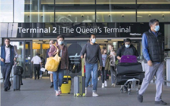 ?? PHOTOGRAPH: MARCIN NOWAK/LNP ?? Travellers arriving at Heathrow. Concerns have been expressed over the NHS app adapted as a Covid passport