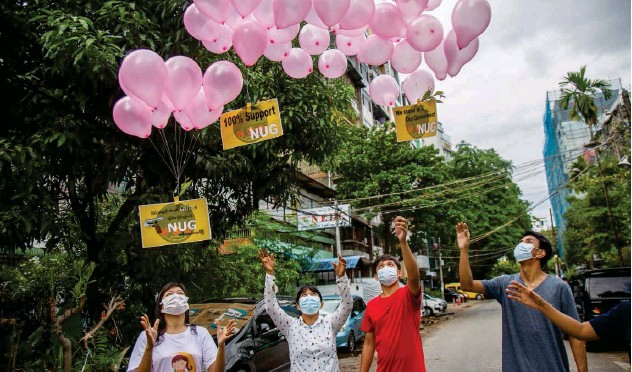 ?? Associated Press ?? ↑ Protesters release balloons with posters reading 'We Support NUG' that stands for 'national unity government' in Yangon on Saturday.