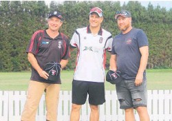 ??  ?? Black Cap Neil Wagner with Ben Warren (left – 300 games for Katikati Cricket Club) and Matt Earl (200 games for the club).