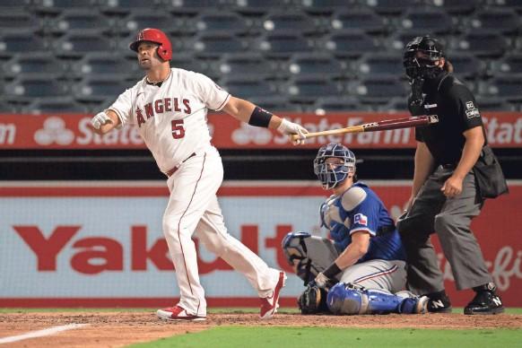 ?? USA TODAY SPORTS ?? Twenty-year MLB player Albert Pujols slugged his 662nd career home run in September.