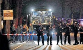 ?? AP ?? Police officers stand in front of football team Borussia Dortmund's damaged bus after the Tuesday night explosions.