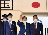 """?? (AP/Kyodo News) ?? """"I hope to develop a relationship of trust with President Biden,"""" Japanese Prime Minister Yoshihide Suga (center) said Thursday as he leaves Tokyo for the U.S. Suga will be the first foreign leader to have face-to-face talks with President Joe Biden."""