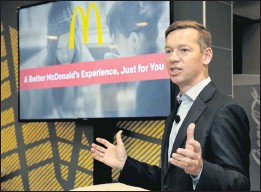 ?? THE ASSOCIATED PRESS ?? Chris Kempczinski, shown in 2016 as the incoming president of McDonald's USA, spoke during a presentation at one of the chain's restaurants in New York CIty.