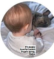 ??  ?? It's puppy love for Lauren Pope's sprog, Raine
