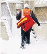 ??  ?? Snow makes life harder for posties