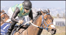 ?? Pictures: LIESL KING ?? Right: LEGAL EAGLE, with Anton Marcus up, wins the Gr 1 L'Ormarins Queen's Plate.
