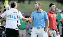 ?? PICTURE: AP ?? BANG BANG: Dustin Johnson, centre, celebrates with his caddie, Austin Johnson, after Johnson defeated Jon Rahm, right, of Spain, to win the Dell Technologies tournament at Austin County Club yesterday.