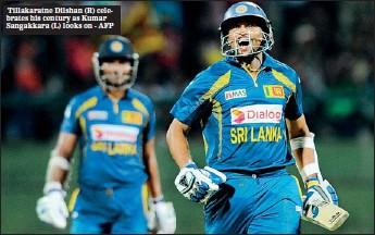 ??  ?? Tillakaratne Dilshan (R) celebrates his century as Kumar Sangakkara (L) looks on - AFP
