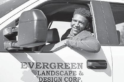 ?? KENNETH K. LAM/BALTIMORE SUN ?? DeAndre Chase, 23, works for Evergreen Landscape & Design Corp.