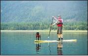 ?? Courtesy, Donna George ?? Tony Palmer and his dog Rascal enjoy a peaceful paddle.