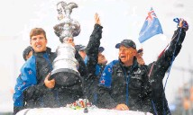 ?? Photo / Getty Images ?? Peter Burling and Grant Dalton celebrate with the America's Cup after Team NZ's win.