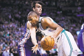 ?? Charles Krupa / Associated Press ?? Al Horford, right, drives to the basket against the 76ers' Dario Saric on Wednesday.