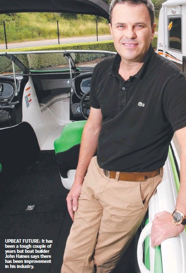 ??  ?? UPBEAT FUTURE: It has been a tough couple of years but boat builder John Haines says there has been improvement in his industry.