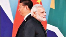 ?? PHOTO: PTI ?? Prime Minister Narendra Modi ( right) and Chinese President Xi Jinping at the 2017 BRICS Summit in Xiamen, China on Monday