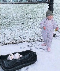 ??  ?? • Ada, aged 2, going sledging for the first time