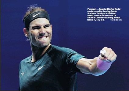 ?? PHOTO: REUTERS ?? Pumped . . . Spaniard Rafael Nadal celebrates after beating Greek Stefanos Tsitsipas in his final roundrobin match in the ATP Finals in London yesterday. Nadal won 64, 46, 62.