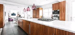 ?? Beci Peckham / Houzz ?? Homeowners are shifting to transitional kitchens with classic, simple lines, according to the 2021 Kitchen Trends study.