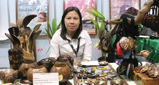 ??  ?? Janelle de Guzman of Tagbung Crafts manning their booth at the recent Coconut Expo at the SMX Convention Center in Pasay City.