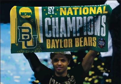 ?? PHOTOS BY DARRON CUMMINGS — THE ASSOCIATED PRESS ?? Baylor guard MaCio Teague celebrates after the Bears' national championship win Monday against No. 1 Gonzaga. Baylor won 86-70.