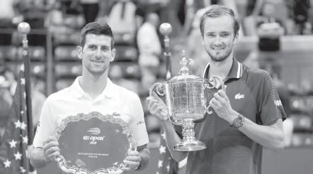 "?? JOHN MINCHILLO/ASSOCIATED PRESS ?? Daniil Medvedev, right, beat Novak Djokovic in straight sets in the U.S. Open men's final. ""He came out very determined,"" Djokovic said."