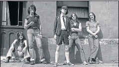 ??  ?? 1976 Malcolm Young, Bon Scott, Angus Young, Mark Evans and Phil Rudd at Pinewood Studios in London