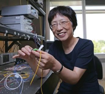 ?? Ottawa photo University of ?? Physicist Xiaoyi Bao in her fibre optics laboratory at the University of Ottawa.