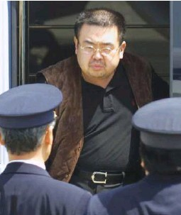??  ?? North Korean heir-apparent Kim Jong Nam emerges from a bus as he is escorted by Japanese authorities upon his deportation from Japan at Tokyo's Narita international airport May 4, 2001. (Reuters)