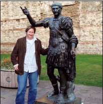 ?? SUBMITTED PHOTO ?? Pandemics of the ancient world will be the subject of a presentati­on by Dr. Kevin McGeough of the University of Lethbridge, at a virtual event hosted by the South Eastern Alberta Archaeolog­ical Society on Feb. 24. In the photo McGeough stands next to a statue in London, England.