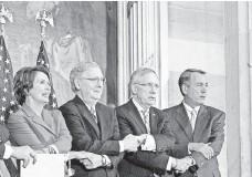 ?? DREW ANGERER, GETTY IMAGES ?? House Democratic leader Nancy Pelosi, Senate Republican leader Mitch McConnell, Senate Majority Leader Harry Reid and House Speaker John Boehner.