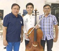 ??  ?? Congressman Eric Singson (left) with Candon scholar Christian Geo Molina, who is now a cellist with the Manila Symphony Orchestra and Manila Symphony Junior Orchestra.
