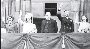 ?? AP file photo ?? V- E Day, 1945: Queen Elizabeth II, then a princess, joins, from left, Queen Elizabeth, Prime Minister Winston Churchill, King George VI and Princess Margaret on Buckingham Palace's balcony in London.