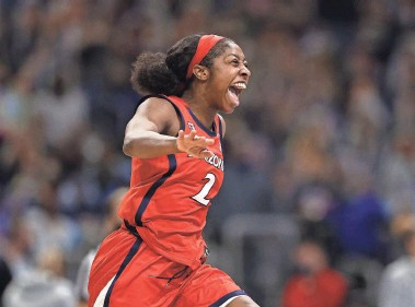 ?? ELSA/GETTY IMAGES ?? Aari McDonald of the Arizona Wildcats celebrates after defeating the UConn Huskies in the Final Four semifinal game of the NCAA Women's Basketball Tournament at the Alamodome on April 2.