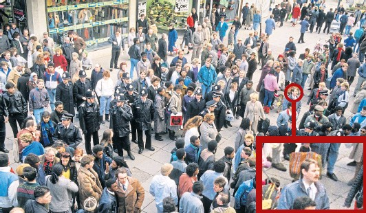 ??  ?? EIGHTIES UNREST: Police officers mingle with crowds in in Dudley Street, Wolverhampton, following the death of Clinton McCurbin in 1987, an event David witnessed as reporter