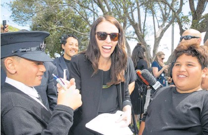 ?? Photo / Mark Mitchell ?? Jacinda Ardern took time to answer questions from children at the Rangitahi Village.