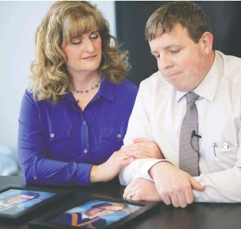 ?? FILES ?? Shauna and Jason Caldwell, whose 17-year-old twin sons died on Feb. 6, 2016 at Winsport after they crashed into a barrier between the bobsled and luge runs, have experienced grief in all its forms.