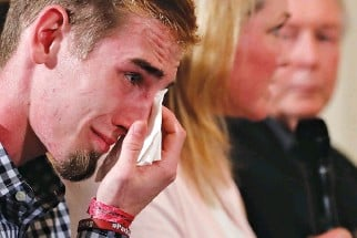 ??  ?? MARJORY STONEMAN Douglas High School student Samuel Zeif cries after his remarks to US President Donald J. Trump during his listening session with school shooting survivors and students at the White House in Washington, Feb. 21.
