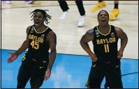 ??  ?? Baylor guard Davion Mitchell (45) and Baylor guard Mark Vital (11) celebrate at the end of the championsh­ip game against Gonzaga on Monday at Lucas Oil Stadium.