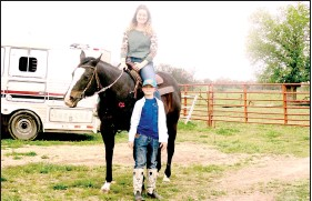 ?? (NWA Democrat-Gazette/Marc Hayot) ?? Savannah Pearson Stricklen (left) and her stepson Keaton Stricklen pose with her horse Bella. Savannah Stricklen has competed with Bella since she was 14. Savannah Stricklen thinks Keaton will one day start roping like her father Phil Pearson.