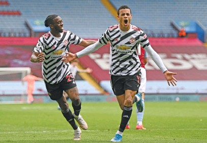 ?? Picture: AFP ?? EARNING THE STRIPES. Manchester United's Mason Greenwood (right) celebrates scoring a goal during their English Premier League clash against Aston Villa at Villa Park yesterday.