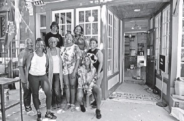 ?? KIM HAIRSTON/BALTIMORE SUN ?? Cole, from left, Aisha Pew, Gilda Pew, Melita Brown, Myah Willis, Nae Coppage-Goodwin, Cierra Lione and Sierra Underdue are the team that is reopening Dovecote Cafe. The cafe and community hub reopens today with its 5th annual Juneteenth Celebration.