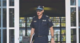?? ?? NT Police Sergeant Xavier McMahon leaves the Supreme Court after giving testimony.