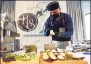 "?? Tyler Sizemore / Hearst Connecticut Media ?? Hudson Social chef Neftali Gonzalez makes tomato jam crostini at the ""Mini Taste of Stamford"" event at Residence Inn by Marriott in Stamford on Wednesday."