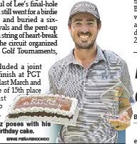 ?? ERNIE PEÑARENDONDO ?? Nicolas Paez poses with his trophy and birthday cake.