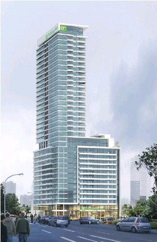 ?? ARTIST'S RENDERING COURTESY OF SUMMIT PROPERTY MANAGEMENT ?? Liv apartments, scheduled for completion in the fall, tower above the 15 floors of the new Holiday Inn hotel at 1390 René-Lévesque Blvd. W. The rental apartments occupy the 17th to 37th floors, with penthouses on the top two floors. An indoor pool,...
