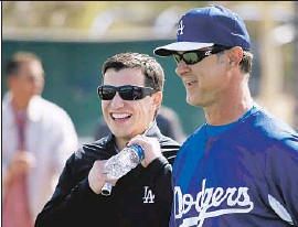 ?? Luis Sinco Los Angeles Times ?? ANDREW FRIEDMAN, the Dodgers' first-year president of baseball operations, chats with Manager Don Mattingly during spring training.