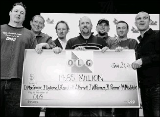 ?? Aaron Lynett, Postmedia News ?? Former co-workers, from left, Joseph Reaman, James Reaman, Michael Maddocks, Daniel MacGregor, Jason Dykema, Daniel Campbell and Adam Barnett were shocked to learn they were cheated out of a Lotto Super 7 jackpot in 2003. They received their winnings,...